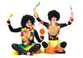 Two funny female aborigines in native costumes and wigs Royalty Free Stock Photo