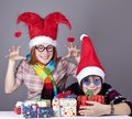 Two funny girls with christmas gifts. Stock Photography