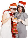 Two funny girls taking out their christmas present Stock Photography