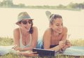 Two funny happy young women friends enjoying summer day outdoors Royalty Free Stock Photo