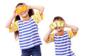 Two funny kids with fruits on face Stock Photography
