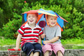 Two funny kids and umbrella. Summer rain Royalty Free Stock Photo