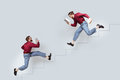 Two funny twin men with books running up and down Royalty Free Stock Photo