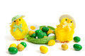 Two funny yellow chickens with green nest and sweet drops Stock Image