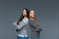 Two funny young women making moustache with their hair Royalty Free Stock Photo