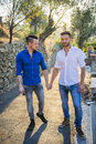 Two gays in park hand in hand Royalty Free Stock Photo