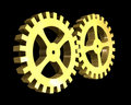 Two gears in gold (3D) Royalty Free Stock Photos