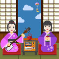 Two Geisha with tea cup and shamisen tea ceremony Royalty Free Stock Photo