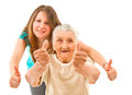 Two generation s thumbs up young women with her grandmother showing on an isoltad backgroundq Royalty Free Stock Photos