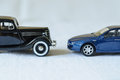 Two generations cars toy as stand each other Stock Photos