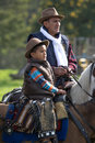 Two generations of cowboys in saddle Royalty Free Stock Photo