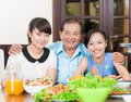 Two generations family portrait of a grandfather and his granddaughters at the family dinner Royalty Free Stock Photo