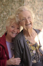 Two generations of mature women hugging and smiling Stock Image