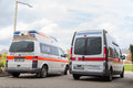 Two german ambulance vehicles stands on hospital
