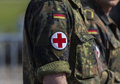 Two german army soldiers with a red cross brassard Royalty Free Stock Photo