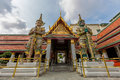 Two giant stand  in front of the gate in the Wat Phra Kaew, Bangkok, Thailand Royalty Free Stock Photo