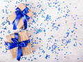 Two gift boxes with blue ribbons on a white background with sparkles. Copy space Royalty Free Stock Photo