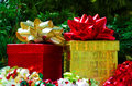 Two gift boxes with bows on the christmas tree background Stock Photos