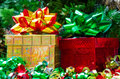 Two gift boxes with bows on the christmas tree background Stock Images