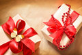 Two gift boxes tied with a red satin ribbon Royalty Free Stock Photo