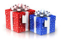 Two gift or present boxes with ribbon bows and label tags Royalty Free Stock Photo