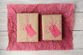 Two Gifts on Red Tissue Paper Royalty Free Stock Photo