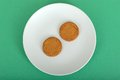 Two Ginger Nut Biscuits on a Plate Royalty Free Stock Photo