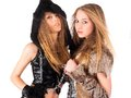 Two girl in barbarian and cat costumes Royalty Free Stock Photos
