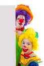 Two girl clowns holding empty text board Royalty Free Stock Photo