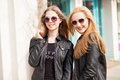 Two girl friends hanging out in the city Royalty Free Stock Photo