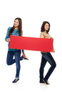 Two girl friends with red banner Royalty Free Stock Photo