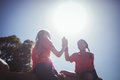 Two girl giving high five to each other during obstacle course training Royalty Free Stock Photo