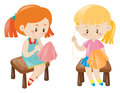 Two girl sewing handkerchief Royalty Free Stock Photo