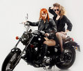 Two girlfriend on a motorbike Royalty Free Stock Photos