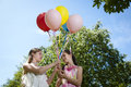 Two girlfriends with balloons Stock Photography