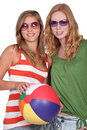Two girlfriends with a beachball Royalty Free Stock Image