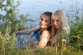 Two girlfriends on the nature Royalty Free Stock Photo