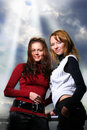Two girlfriends over dramatic sky Royalty Free Stock Photos