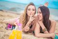 Two girlfriends resting on the beach Royalty Free Stock Photo