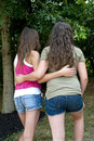 Two girlfriends walking together park shot vertically Stock Image