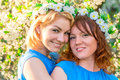 Two girlfriends with wreaths on the head Royalty Free Stock Photo
