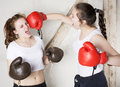 Two girls as boxers young dressed are fighting Royalty Free Stock Image