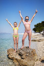 Two girls on beach of sea at summer Stock Images