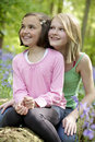 Two girls and bluebells Royalty Free Stock Photo