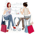 Two girls at a cafe Royalty Free Stock Photos