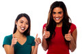 Two girls cheering up with thumbs up cool friends showing double Royalty Free Stock Photography