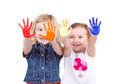 Two girls or children with paint on their hands on an isolated white background Stock Photo