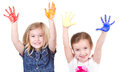 Two girls or children with paint on their hands on an isolated white background Stock Image