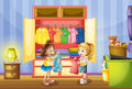 Two girls choosing clothes from closet Royalty Free Stock Photo