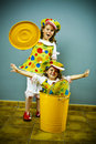 Two girls with a clown costume Royalty Free Stock Image